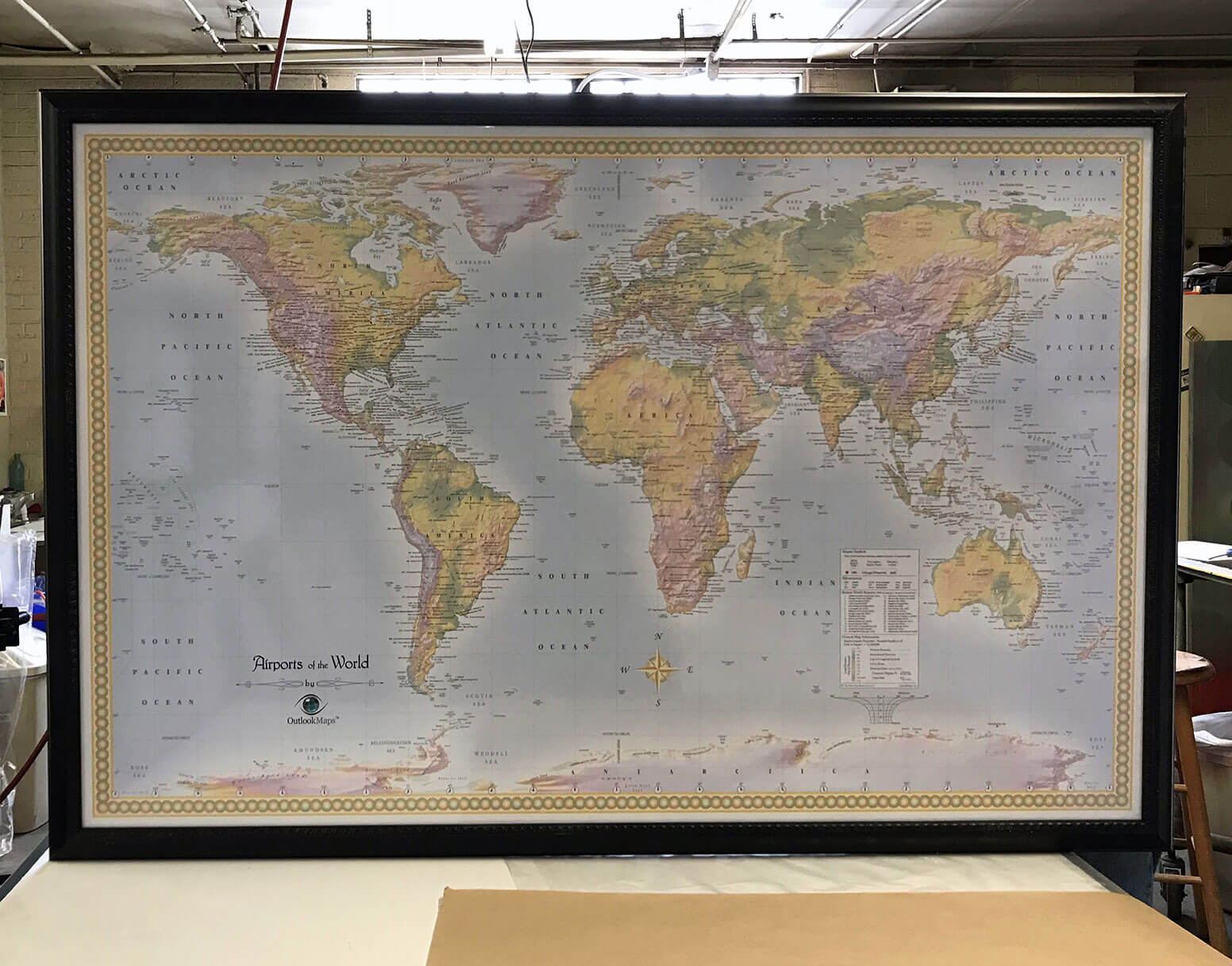 "Lisa Peters (Lightravels® owner) with large custom size map (CSNGWM)  (Outer Frame Dimensions: 45½""w x 32½""h x 3""d)"