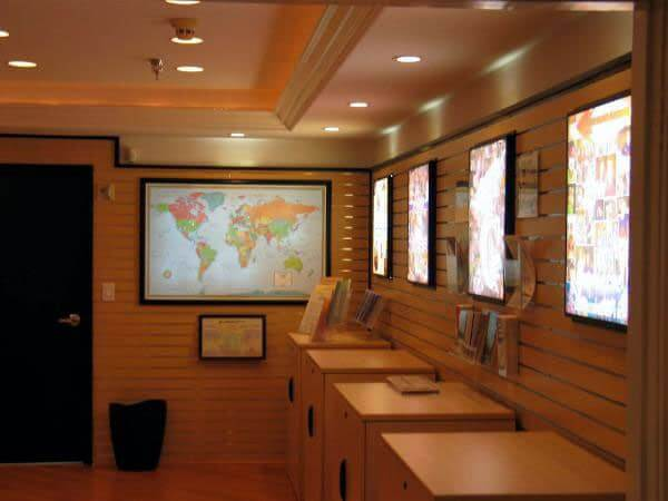 "The Church's Resource Center displays an illuminated Lightravels® Custom World Map to use as a tool to guide visitors to the locations of their Missionaries. (Outer Frame Dimensions: 52½""w x 35""h x 3""d)"