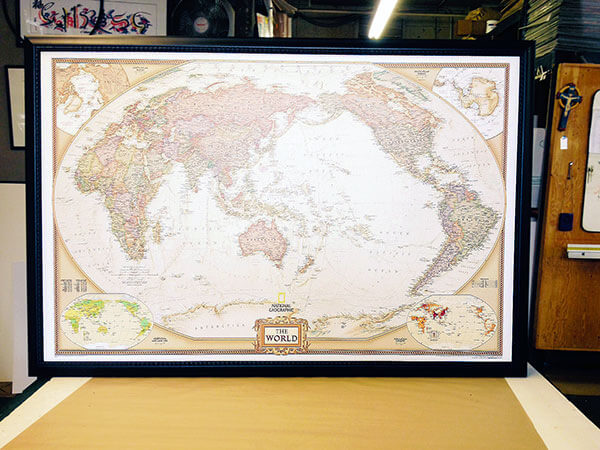 "With an antique-style color palette, this laminated National Geographic large custom size map (CSNGEWM) features present-day political boundaries, possessions, territories, and place-names.  (Outer Frame Dimensions: 45½""w x 32½""h x 3""d)"